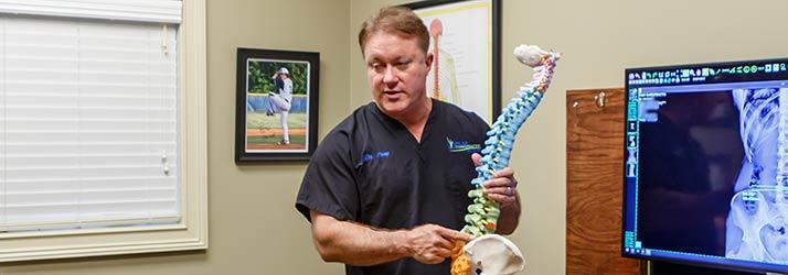 Chiropractor Ringgold GA Dr. Charles Pray Explaining Spine